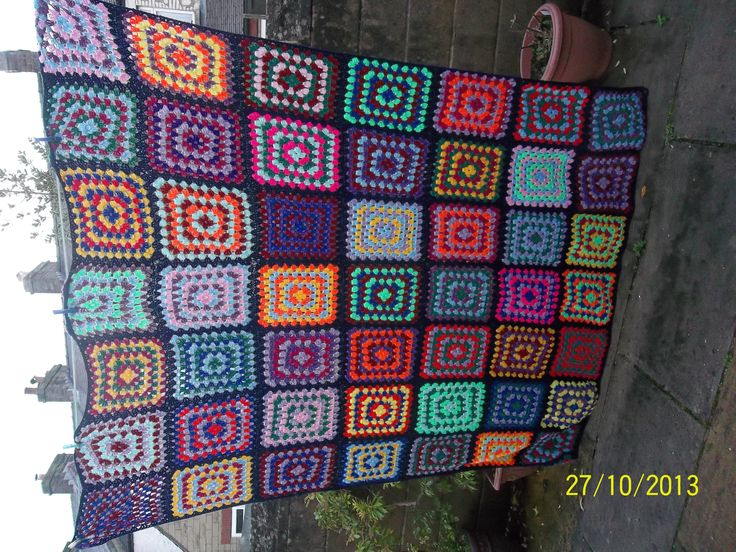 Quilt made by me (Amanda) as my sister's wedding present. It fits a double bed and is edged in double crochet (UK)