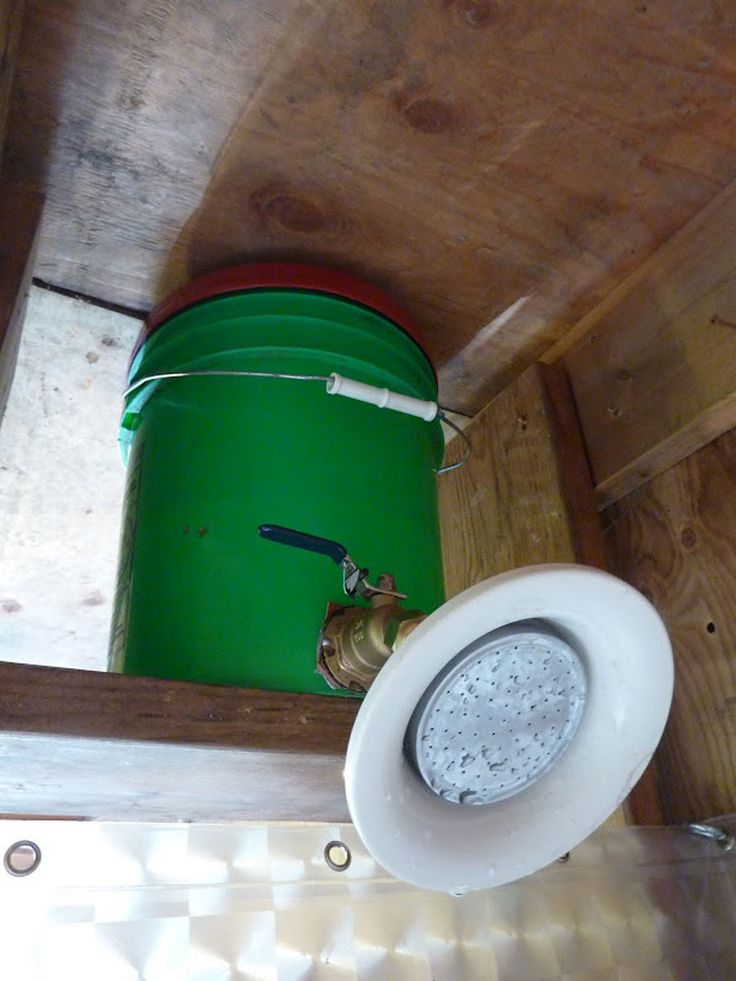 9-tiny-cabin-shower. Someone suggested an aquarium heater to warm the water to 90 degrees. Others suggested a rain barrel or other means to catch rainwater could flow into this.