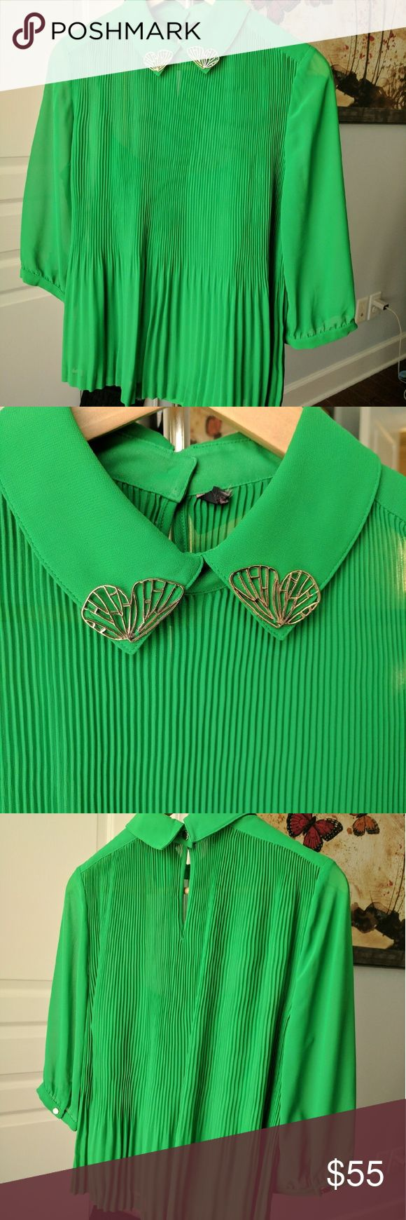 Ted Baker green pleated 3/4 sleeve blouse collar Brand new top but is overstock so Ted Baker label was cut out. This is a Ted size 2 equal to a 6. Comes with green cami as well to wear underneath. Gold buttons on sleeves and back of neck. Ted Baker Tops Blouses