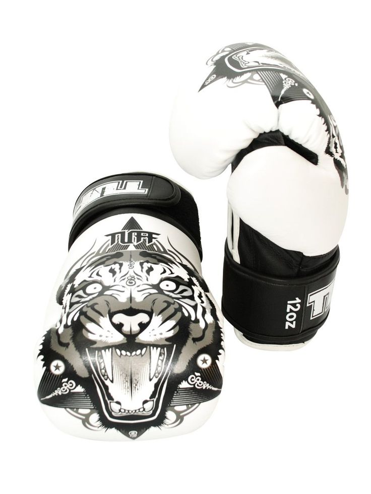 Tiger Fancy Boxing Gloves (White) by Tuff on Guruwan.com | TUFF White Tiger Fancy Boxing GlovesLight weight gloves that are suitable for pads, bags and sparringWith durable velcro wrist closureMaterial: High grade authentic leather
