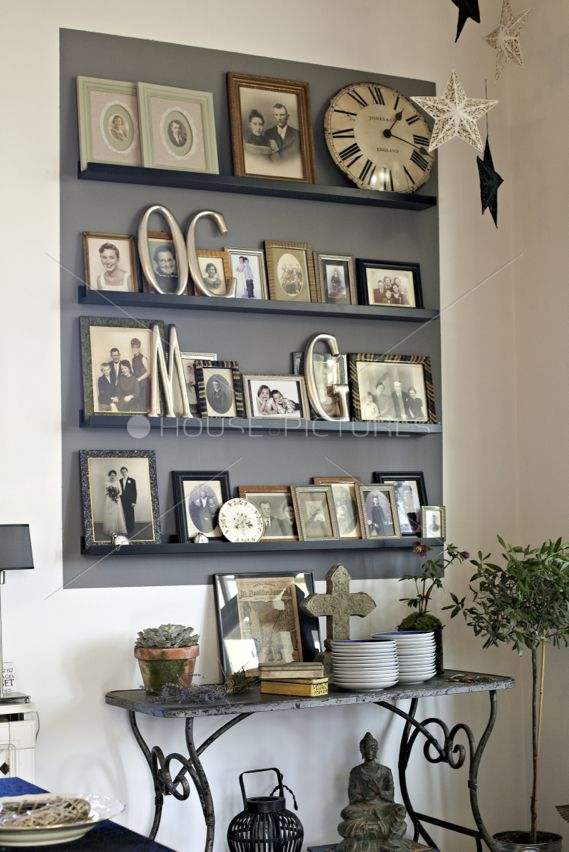 A photo display board reduces holes in the wall and you can change the look anytime.