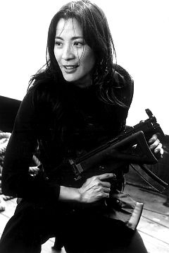"""Michelle Yeoh as a Bond girl.     """"I always prefer my Bond women competent on their own, not just damsels to be rescued."""""""