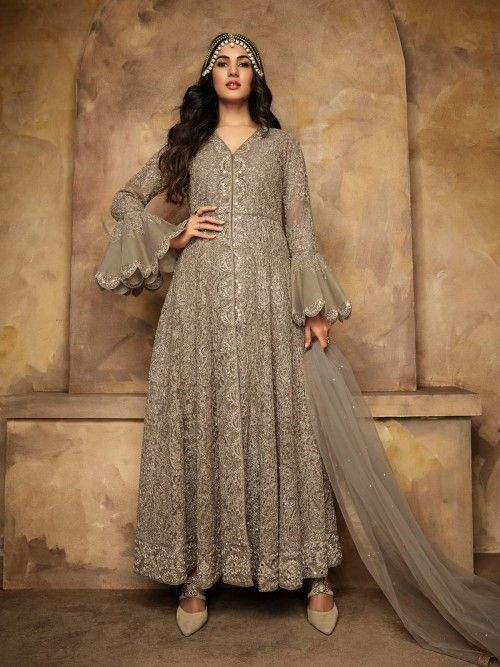 b6754bbaff Bollywood diva sonal chauhan style grey designer anarkali suit online which  is crafted from net fabric