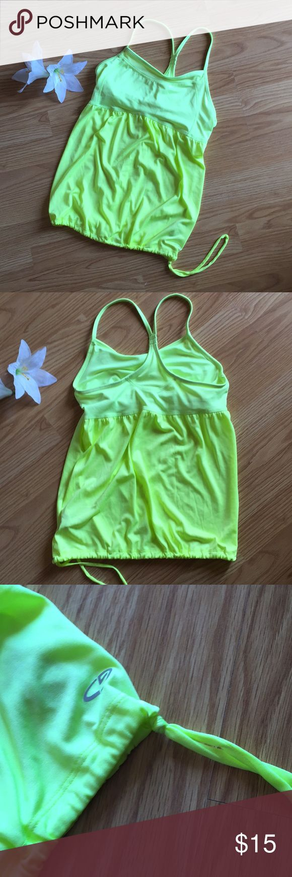 Champion Neon Yellow Bubble Tank Neon yellow bubble tank. Perfect for working out and the bottom is adjustable. Fitted around bust. There is a built in bra but it is not padded.   Size medium. Excellent condition. Champion Tops