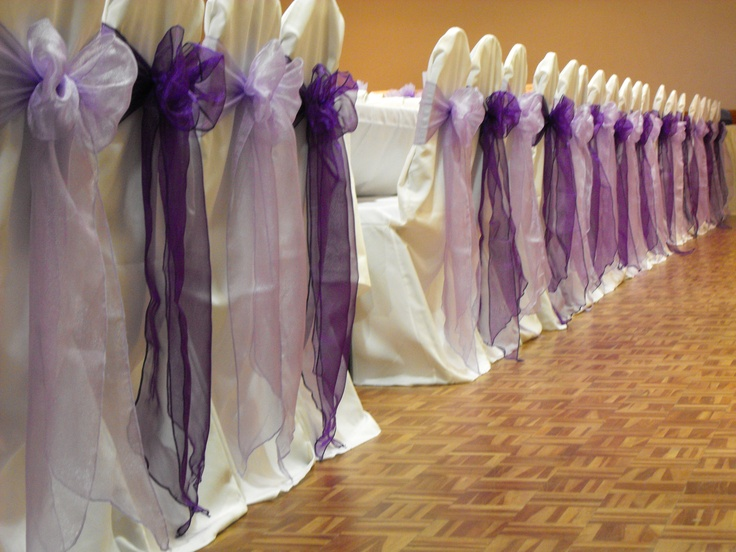 Alternating Cadburys Purple and Lilac Organza Bows on White Chair Covers