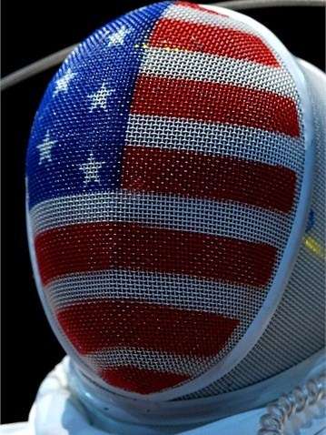 Courtney Hurley of the United States looks on against Laura Flessel-Colovic of France during the Women's Epee Individual Fencing