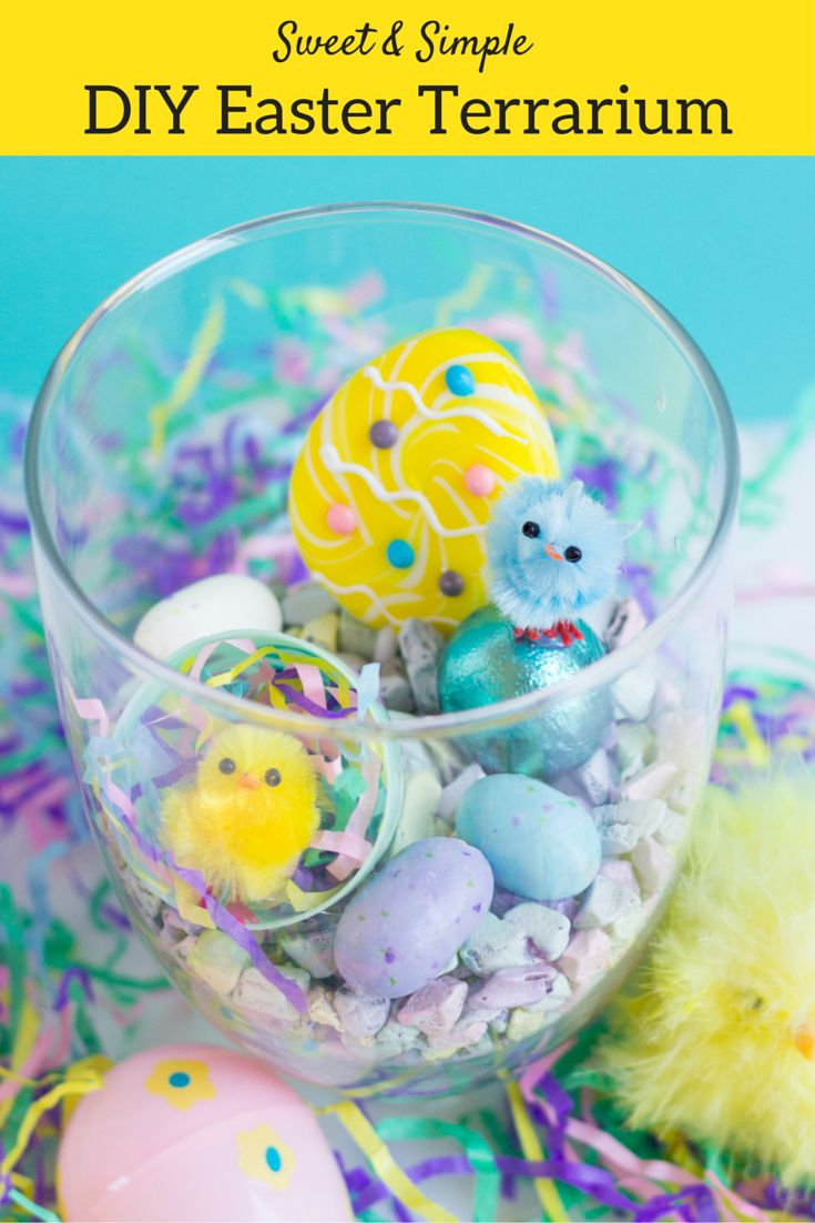 Capture the cheerful feeling of Easter in a jar with these sweet mini terrariums from @dimprovised! Unlike typical terrariums, these don't require a green thumb, just some mini fluffy chicks, pastel colored candies, and a little imagination. Create a grouping of these DIY Easter crafts for pretty Easter decor or as a centerpiece for your Easter brunch. #Easter #DIY #crafts