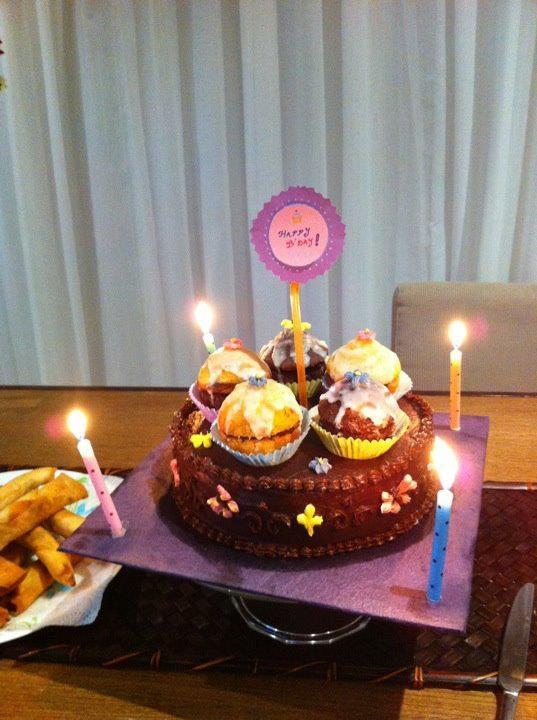 Birthday cake with cupcakes