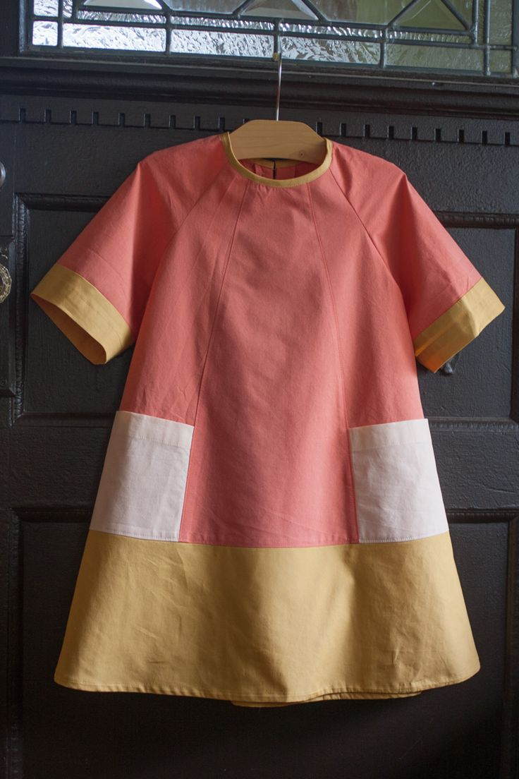 color blocked carousel dress -- probably actually. I have this pattern traced and was planning on just doing light blue chambray, but I like this version as well