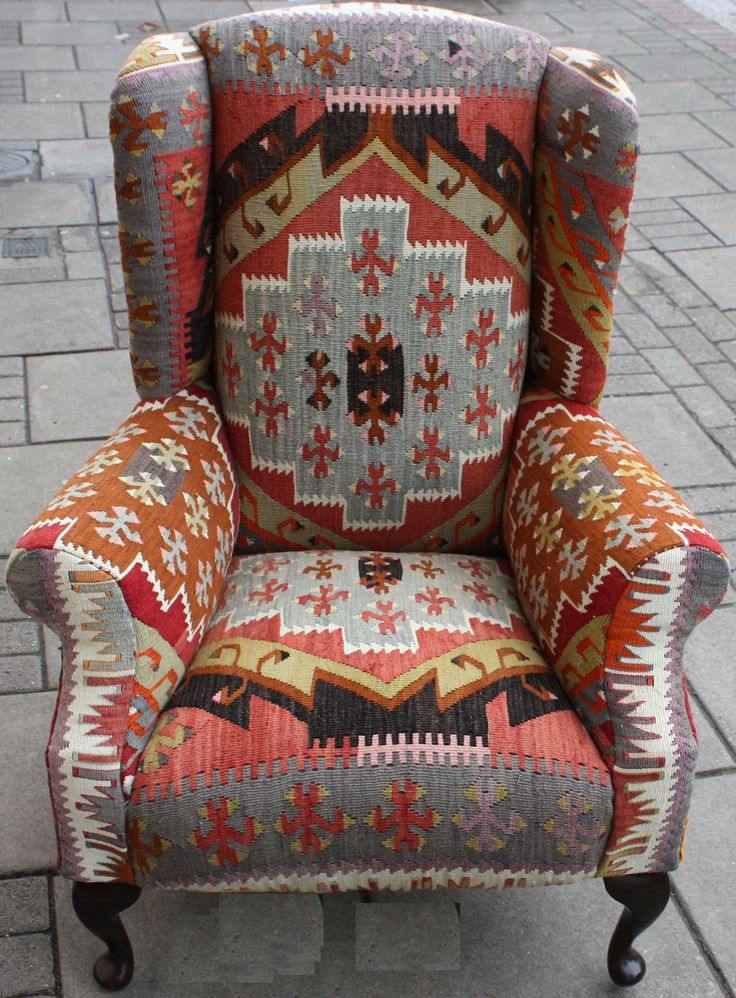 Love this chair! Using a weaving to cover a chair really works great!  It would be a great piece to add some color and flare to a room.