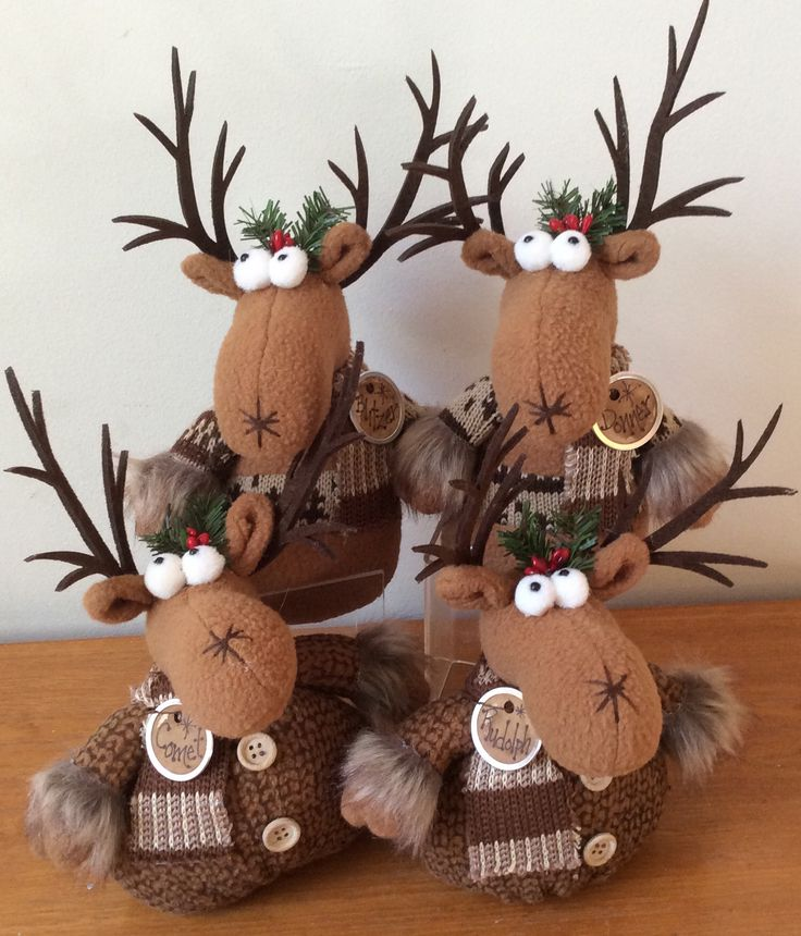 Whimsical Moose sitters crafted from patterned fleece, felt, faux fur and knit fabric.  Each has a coffee stained hang tag with one of Santa's reindeer names printed on it.   $13 ea