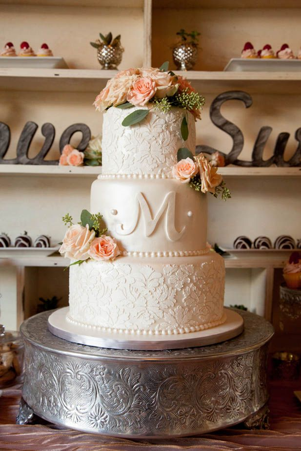 Elegant textured three tier monogram wedding cake with pink roses and floral cake topper (NeriPhoto)