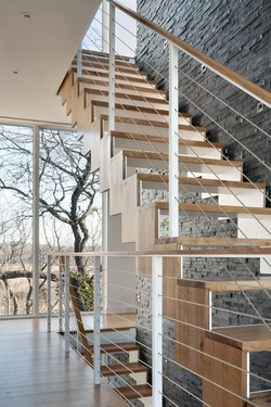 From Dwell. Great open staircase.