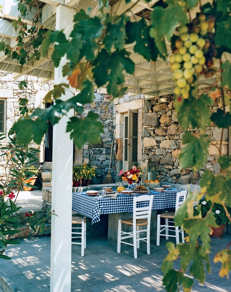 A terrace of a 17th-century volcanic-stone stable on the island of Patmos in Greece. Photographed by François Halard, Vogue, July 2011.