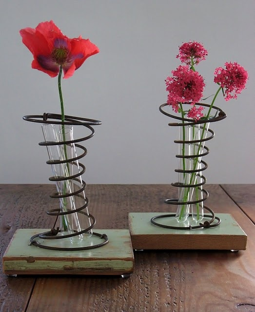 "Metal spring and test tube ""vases"" http://fourcornersdesign.blogspot.com/2011/08/persistence-of-metal-madness.html"