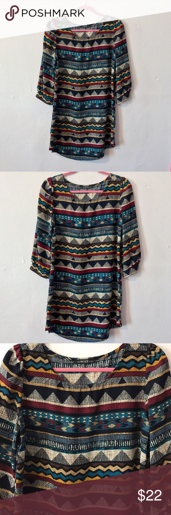Boho Tribal Print Shift Dress mini chic Aztec Midi Perfect little light weight tribal print shift dress. In excellent preloved condition, no signs of wear. Easy to wear and the perfect option for a casual date night, weekend brunch or any occasion that calls for a simple yet exciting look. Fun & bright tribal print that makes you stand out. Also super comfortable and suitable for the workplace. Best fits a size medium or oversized small. Purchased from a boutique in Florida, brand is The…