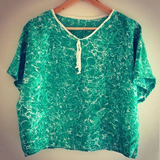 Wear this crop -but not too crop-top with skinny jeans and colorful sneakers!