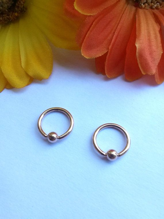 14g Rose Gold Captive Bead Rings for your piercing! Shop online at http://etsy.me/1NMWaDU