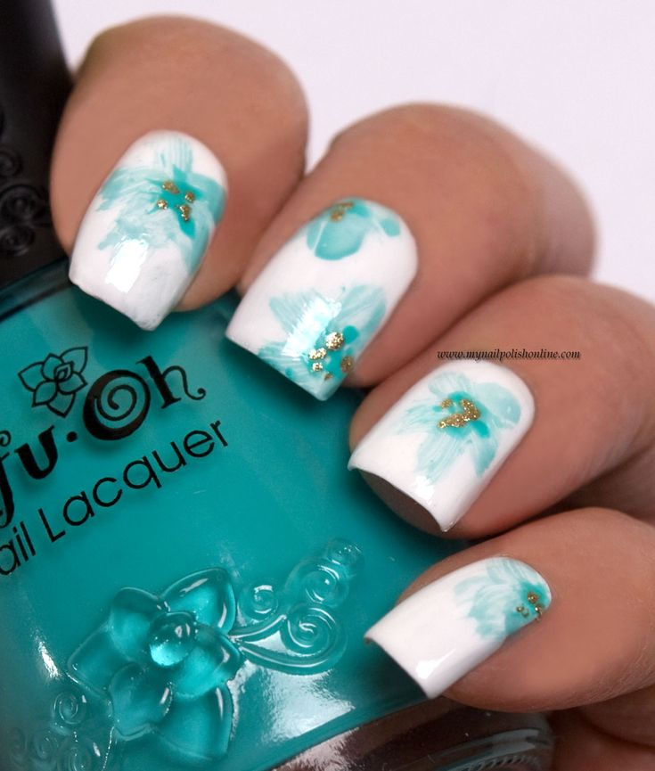 Beautiful blue hues of color on white nail polish to create the design of butterflies, bees, and floral petal leaves.