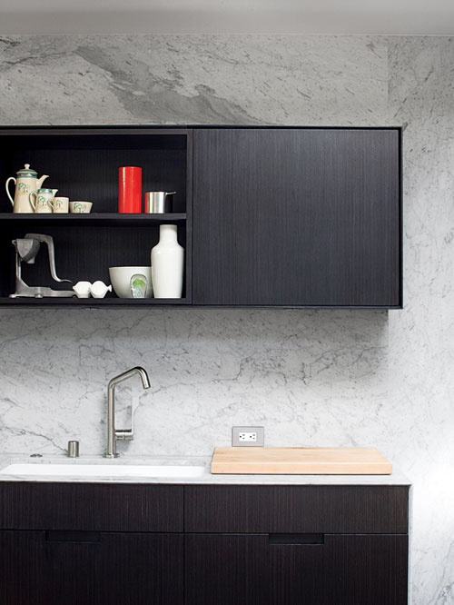 Marble Walls, Black Cabinets. From The Design Traveller.
