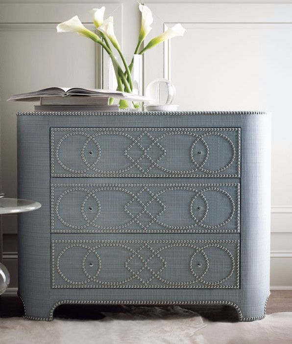 Accent your home with the chic style and textured look of the Villette Chest by Bernhardt Furniture. This gorgeous chest is wrapped in fabric and accented with a stunning Bright Nickel nailhead trim b