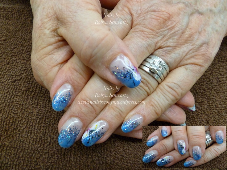 Gel nails, fabulous blue, glitter and hand painted lillies.