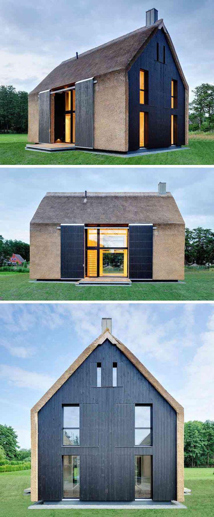 toit de chaume et bardage en bois noir caractérisent la façade de cette maison privée