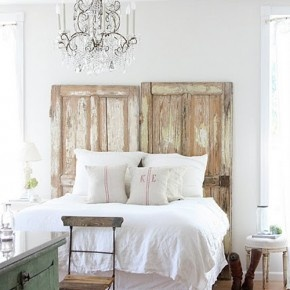 using antiqued doors as a headboard, I like the idea of two making it a taller headboard.
