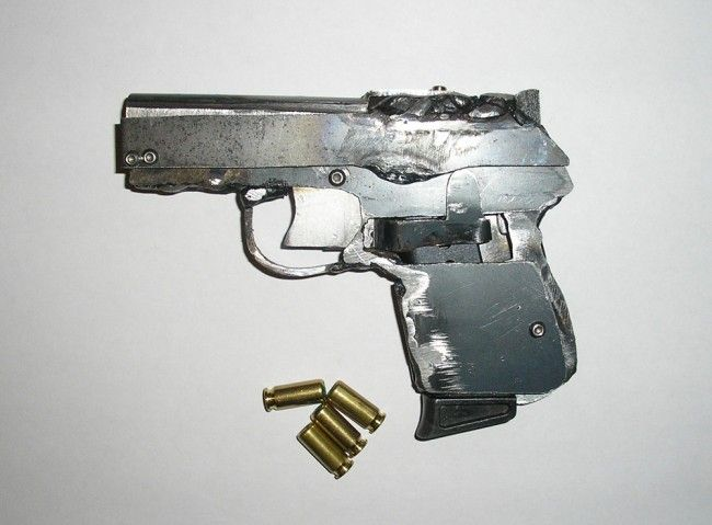 "Sheet Metal SemiAuto Pistol From hand tools and a welder. It'd be cool to make one into a ""laser-pointer case"" raygunprop."