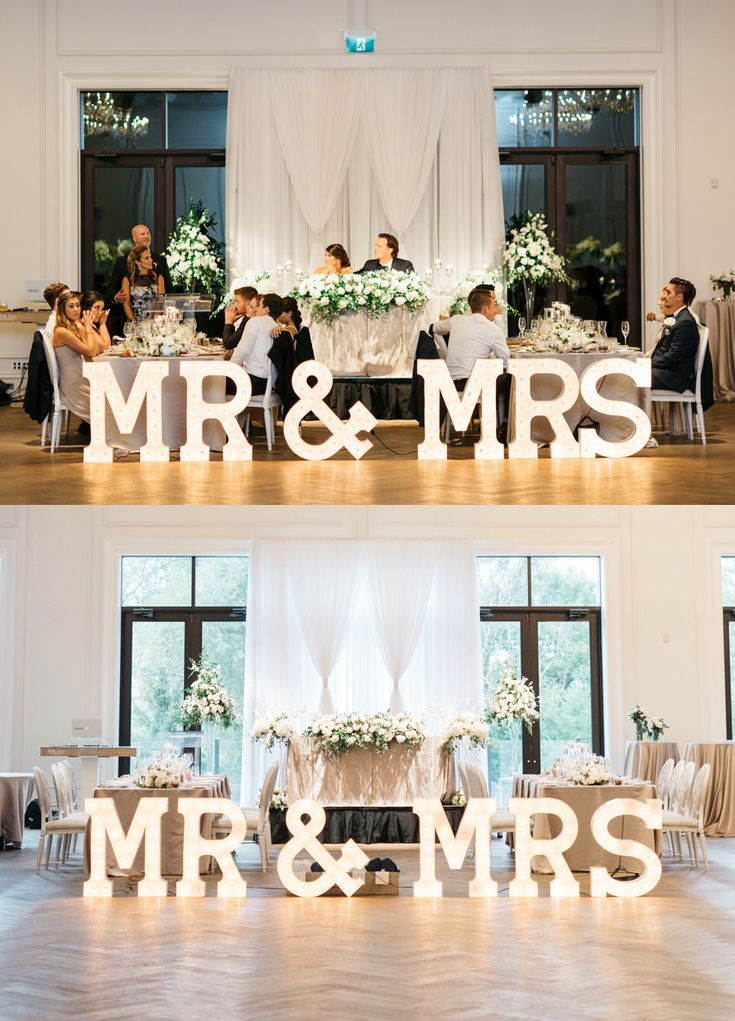 Looking for wedding sweet heart table ideas? Try this Garden Style Flower Arrangements / Greenery Wedding Head Table Inspiration. Make the setup POP with huge MR & MRS marquee letters. Photo taken by Paula Visco at the Arlington Estate (Kleinburg, Ontario). MR & MRS Marquee Letters Setup by VintageBASH.