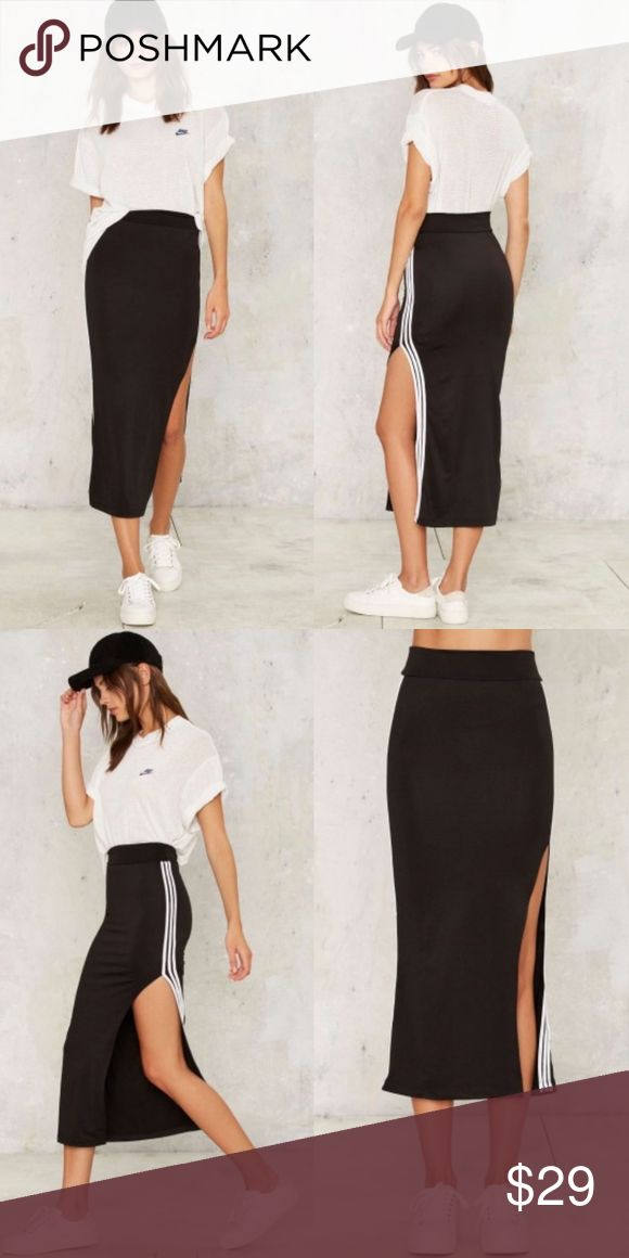 Nasty Gal Track Record Slit Skirt You're right on track. This midi skirt is black and features a slit at side, high-waisted fit, elastic waistband, three white stripes at sides, and stretch in fabric. Unlined. Sold out at Nasty Gal. Boutique Item.  *Body  92% Polyester  8% Spandex  *Hand wash cold  *Made in U.S.A. Nasty Gal Skirts Midi