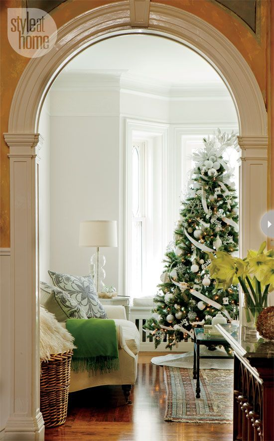 The Christmas tree in the living room is adorned with white and silver Christmas decorations – many nature inspired – which create a look that's both sophisticated and fun. Supplanting the ubiquitous angel or star, the tree's elegant topper is made of a mix of silver and white Christmas balls, ribbon and feathery branches all tied together. - Debbie Travis