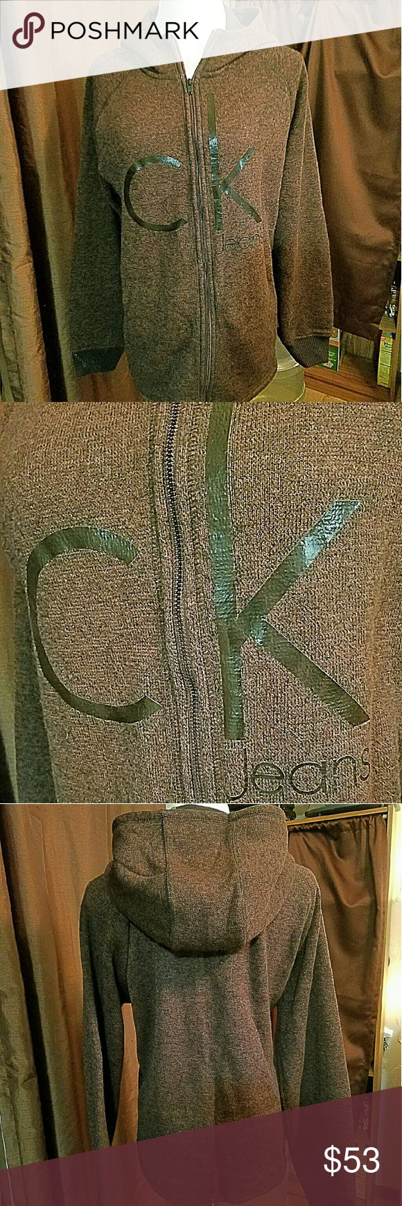 """CALVIN KLEIN ck Jeans Sz Large Textured Hoodie Brand: Calvin Klein Jeans  Item: *Mens ck Jeans Zip Up Hoodie *I have it Listed in Men's But Ladies Could Certainly Wear As Well - See Measurements *The Color is Very Hard to Describe - Kind of a Rusty Maroon Brown *Says ck Jeans on Front *Raglan Sleeves *Black Panels on Each Side *Pockets on Each Side for Hands *Very Good to Excellent Pre-Loved Condition  Armpit to Armpit (flat) - 23"""" Shoulder to Hem - 27""""  *no trades, offers via offer button…"""