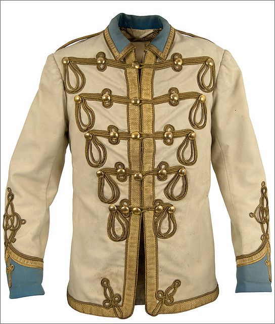 """John Lennon's original jacket worn in 1967 and inspired The Beatles """"Sgt Pepper"""" uniforms."""