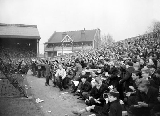 1958, The crowds spill out of the Putney End terrace as Fulham take on Bristol Rovers in the FA Cup Sixth Round at Craven Cottage