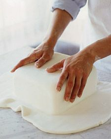 How to make wedding cakes. Save money at your wedding by having someone you know who can bake decently follow these instructions. Beautiful and cheap!