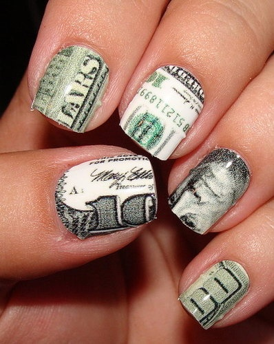 next mani Money Nails... too ghetto? ol well ill put some pink glitter on it they'll make it more me :)
