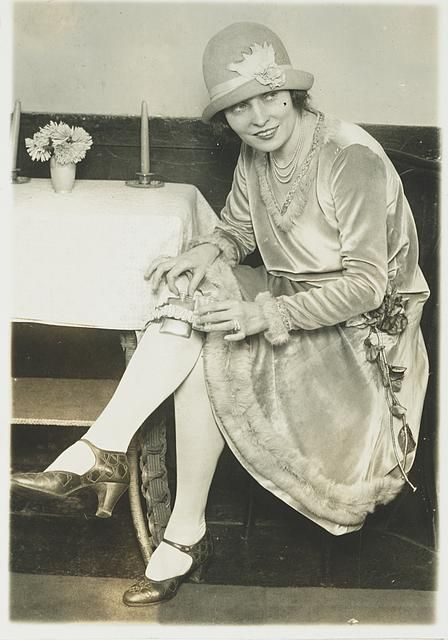 """1926 Washington DC. It was apparently a """"fad"""" to carry a flask in your garter! I like her shoes."""