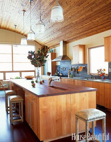 Aspen Kitchen: The island countertop is iroko wood, with remaining countertops in a granite called Verde Eucalyptus.