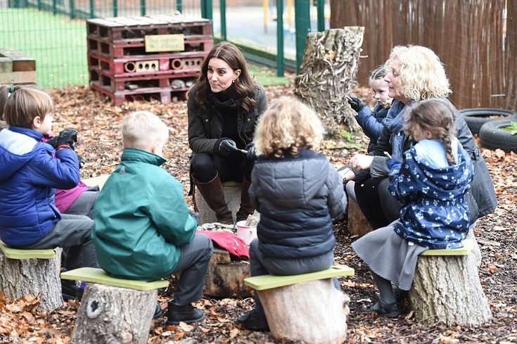 Kate, dressed in her trusty country attire, sat on a tree stump as she sat around and chat...