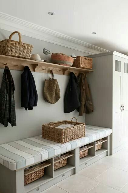 Wide shelf above hanging pegs.