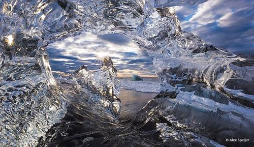 Congratulations to Alex Speijer for winning the recent Go Wide photography assignment with the image Diamond Window. Jokulsarlon Glacier Lagoon is on of Icelands top tourist attractions says Speijer. When the chunks of ice flow though the lagoon outlet and enter the sea some are thrown back at the beach. Temperature and wave action make them melt in crazy ways. This can result in holes in the ice. I had to use my Canon 16-35mm IS at 16mm f/16 to create this picture with my front element just…