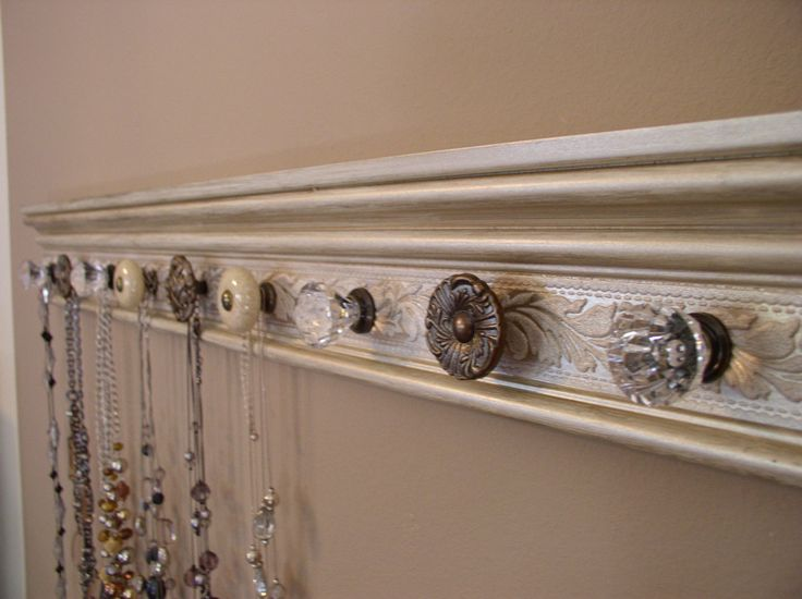 decorative trim piece, paint, add fun cabinet knobs, mount to closet wall. great DIY project for displaying/organizing necklaces.