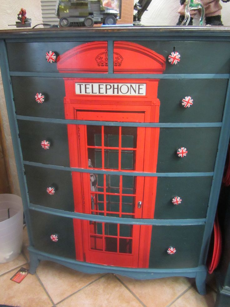 "One of the dressers that I made for the boys' ""Union Jack"" bedroom.  Painted ASCP Aubusson Blue with dark wax and decoupaged a telephone boot onto the drawer fronts."