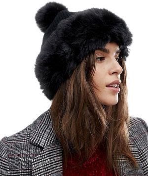 River Island Faux Fur Trim Pom Pom Beanie Hat | Bored of your winter coat? These stylish hats will perk up your cold-weather game, all for under $50.