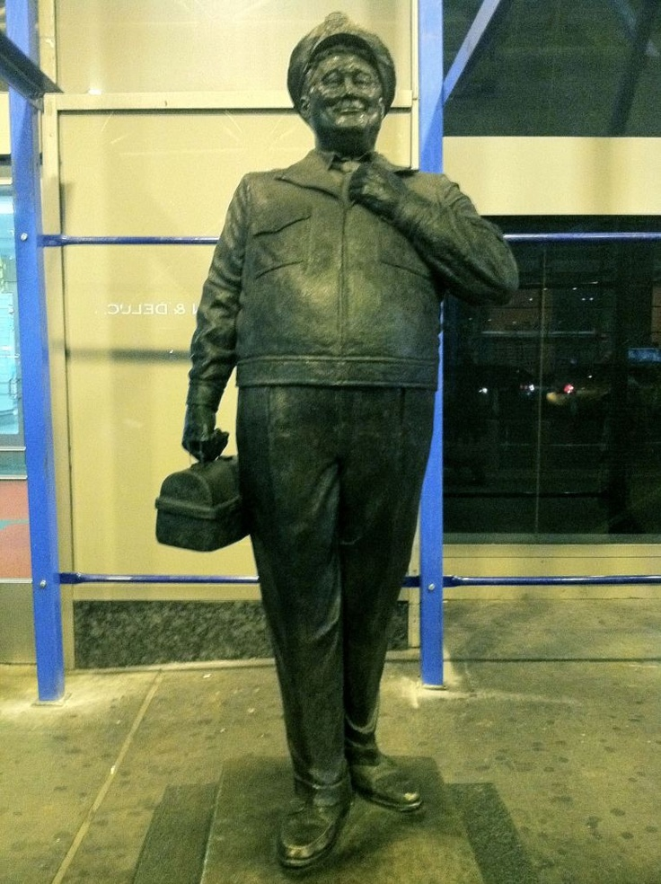 "Jackie Gleason's character of bus driver ""Ralph Kramden"" statue in front of the Port Authority Bus Terminal on 8th Avenue in NYC."
