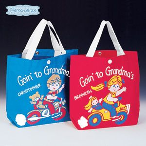 """Product # HC4346 - Makes visiting Grandma's tons of fun! Brightly coloured tote bag with a charming design on front has plenty of room for toys, snacks, a change of clothes, even a favorite 'blankey' - great for a night at Grandma's house! Sturdy canvas with web handles; wipe-clean interior. Personalization: Name, up to 10 characters. 12""""L x 11""""H x 4""""W.   $14.98"""