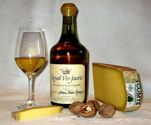 "Wine paired with cheese: Vin Jaune (""yellow wine"") of Jura, France and Franche Comté cheese."