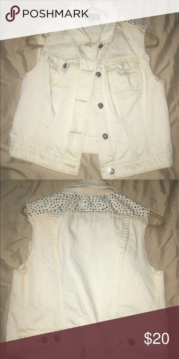 White denim vest White denim vest with a bedazzled top. So cute!! Jackets & Coats Vests