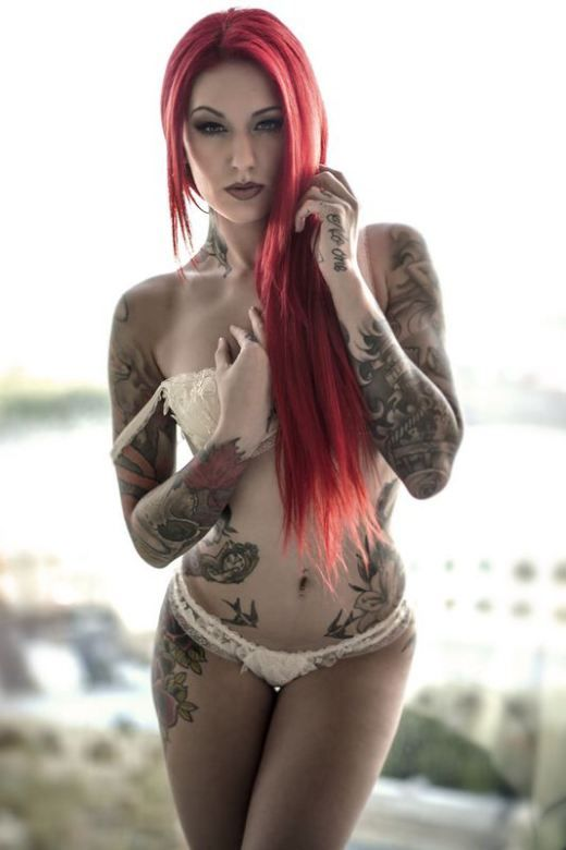 Nude red haired women with tatoos